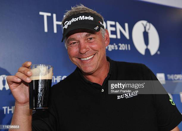 Darren Clarke of Northern Ireland toasts his victory with a pint of Guinness at the end of the final round of The 140th Open Championship at Royal St...