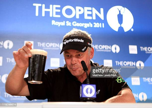 Darren Clarke of Northern Ireland toasts his victory with a pint of Guinness following the final round of The 140th Open Championship at Royal St...