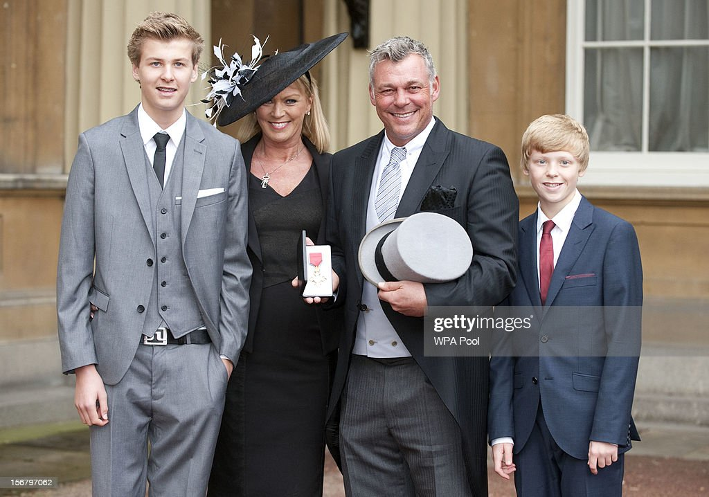<a gi-track='captionPersonalityLinkClicked' href=/galleries/search?phrase=Darren+Clarke&family=editorial&specificpeople=171309 ng-click='$event.stopPropagation()'>Darren Clarke</a> poses with his wife, former Miss Northern Ireland Alison Campbel, and sons, Tyrone (L) and Conor after being awarded an OBE at Buckingham Palace for services to Golf , at Buckingham Palace on November 21, 2012 in London, England.
