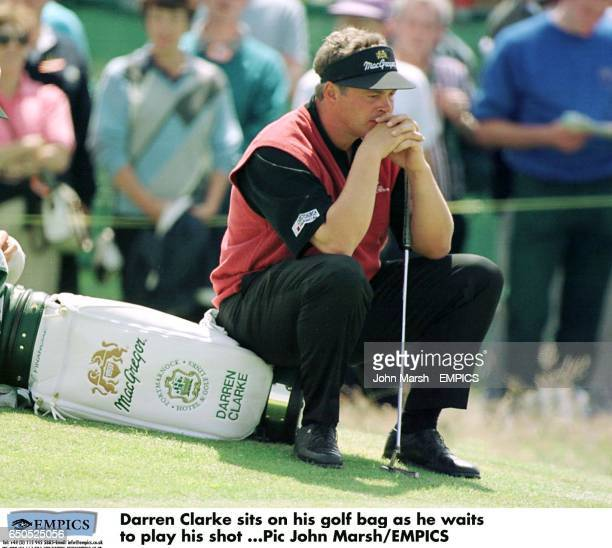 Darren Clarke sits on his golf bag as he waits to play his shot