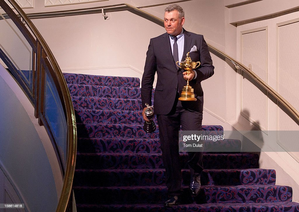 <a gi-track='captionPersonalityLinkClicked' href=/galleries/search?phrase=Darren+Clarke&family=editorial&specificpeople=171309 ng-click='$event.stopPropagation()'>Darren Clarke</a> walks with the Ryder Cup during the PGA Lunch on December 21, 2012 in London, England.