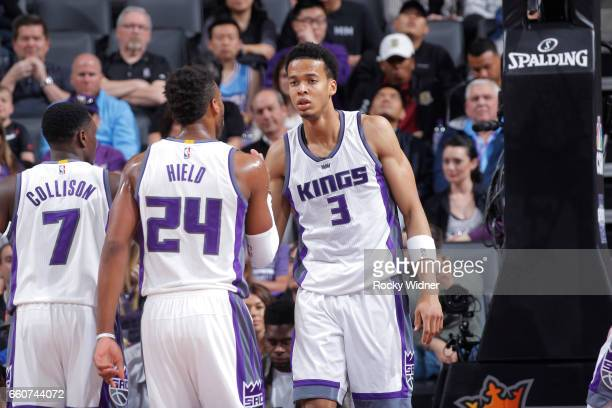 Darren Collison Buddy Hield and Skal Labissiere of the Sacramento Kings face off against the Memphis Grizzlies on March 27 2017 at Golden 1 Center in...