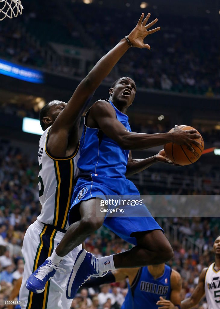 <a gi-track='captionPersonalityLinkClicked' href=/galleries/search?phrase=Darren+Collison&family=editorial&specificpeople=699031 ng-click='$event.stopPropagation()'>Darren Collison</a> #4 of Dallas Mavericks attempts a shot past <a gi-track='captionPersonalityLinkClicked' href=/galleries/search?phrase=Al+Jefferson&family=editorial&specificpeople=201604 ng-click='$event.stopPropagation()'>Al Jefferson</a> #25 of the Utah Jazz during the first half of an NBA game October 31, 2012 at EnergySolution Arena in Salt Lake City, Utah.