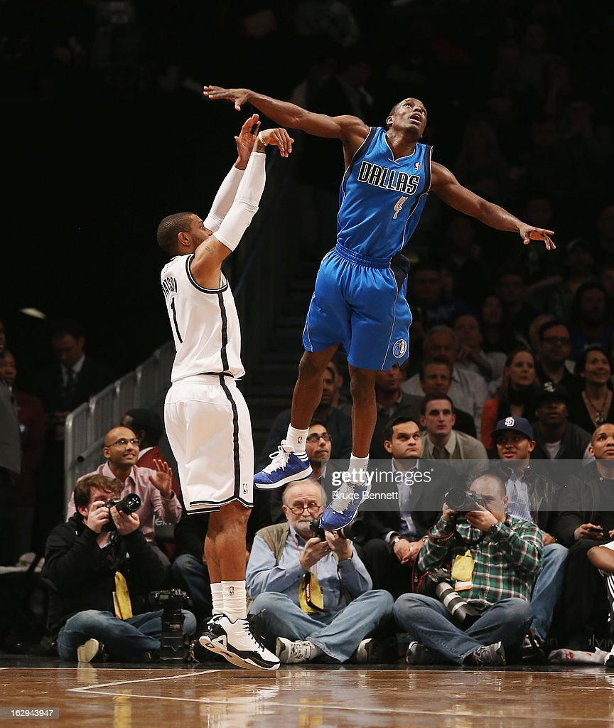 Darren Collison #4 of the Dallas Mavericks attempts to block a shot by C.J. Watson #1 of the Brooklyn Nets at the Barclays Center on March 1, 2013 in New York City.