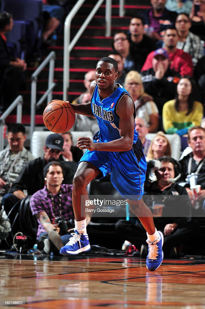 <a gi-track='captionPersonalityLinkClicked' href=/galleries/search?phrase=Darren+Collison&family=editorial&specificpeople=699031 ng-click='$event.stopPropagation()'>Darren Collison</a> #4 of the Dallas Mavericks brings the ball up court against the Phoenix Suns on February 1, 2013 at U.S. Airways Center in Phoenix, Arizona.