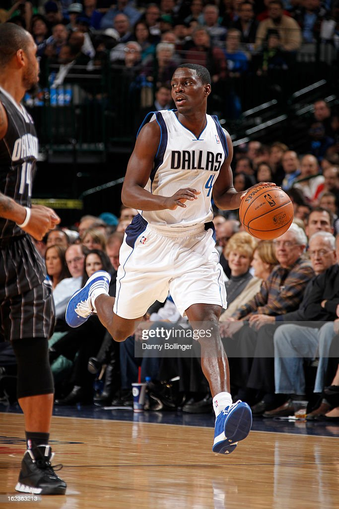 <a gi-track='captionPersonalityLinkClicked' href=/galleries/search?phrase=Darren+Collison&family=editorial&specificpeople=699031 ng-click='$event.stopPropagation()'>Darren Collison</a> #4 of the Dallas Mavericks brings the ball up court against the Orlando Magic on February 20, 2013 at the American Airlines Center in Dallas, Texas.