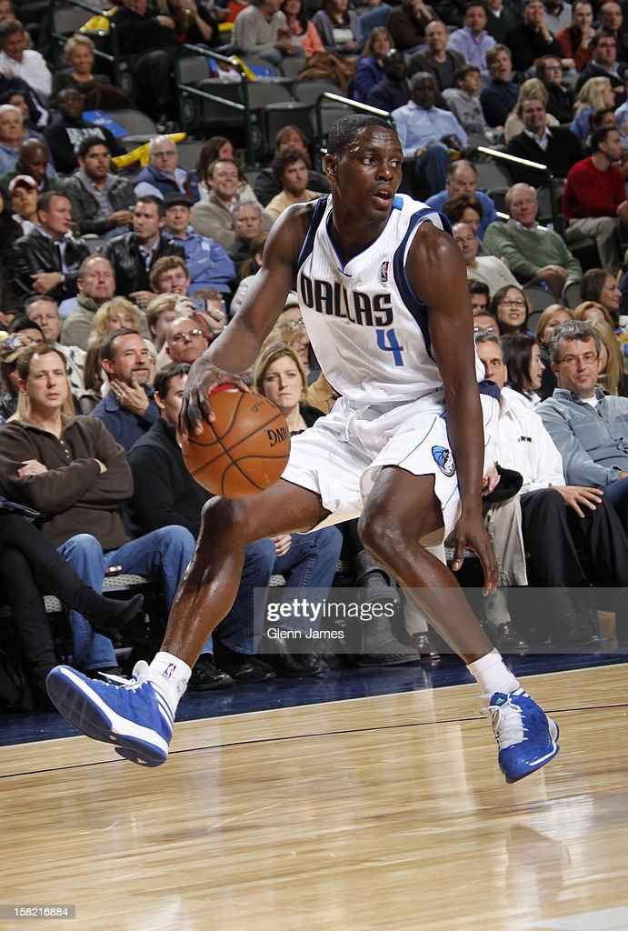 <a gi-track='captionPersonalityLinkClicked' href=/galleries/search?phrase=Darren+Collison&family=editorial&specificpeople=699031 ng-click='$event.stopPropagation()'>Darren Collison</a> #4 of the Dallas Mavericks dribbles the ball against the Sacramento Kings on December 10, 2012 at the American Airlines Center in Dallas, Texas.