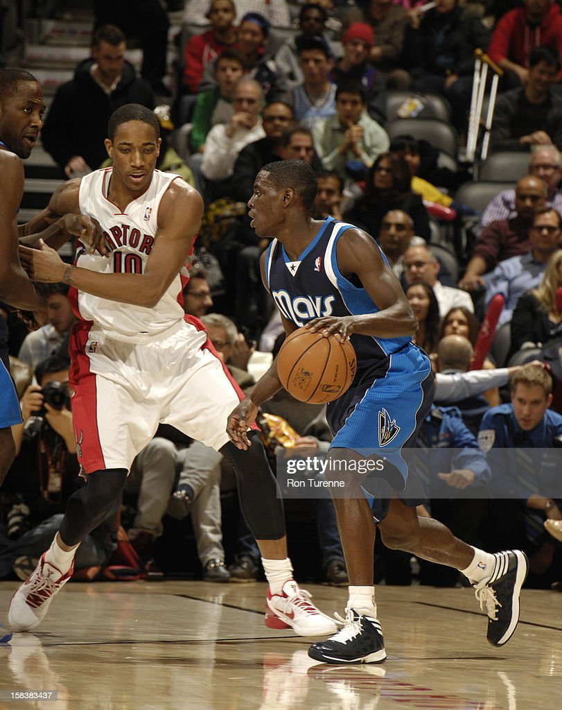 <a gi-track='captionPersonalityLinkClicked' href=/galleries/search?phrase=Darren+Collison&family=editorial&specificpeople=699031 ng-click='$event.stopPropagation()'>Darren Collison</a> #4 of the Dallas Mavericks dribbles the ball against the Toronto Raptors on December 14, 2012 at the Air Canada Centre in Toronto, Ontario, Canada.