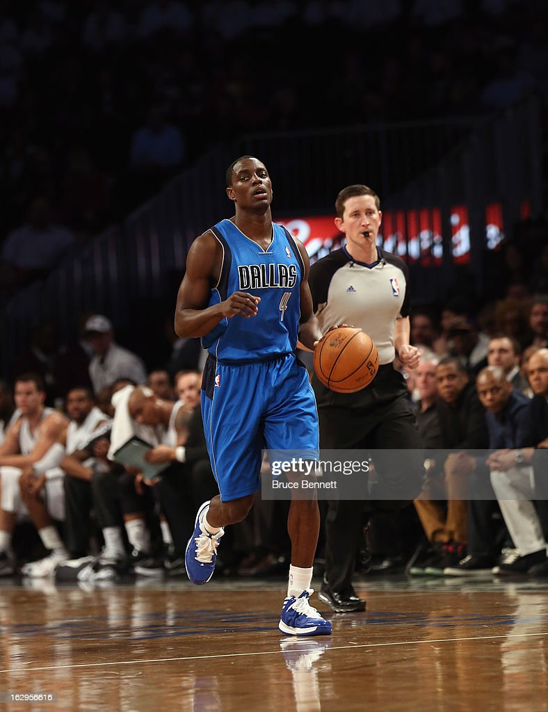 Darren Collison #4 of the Dallas Mavericks dribbles the ball against the Brooklyn Nets at the Barclays Center on March 1, 2013 in New York City. The Mavericks defeated the Nets 98-90.