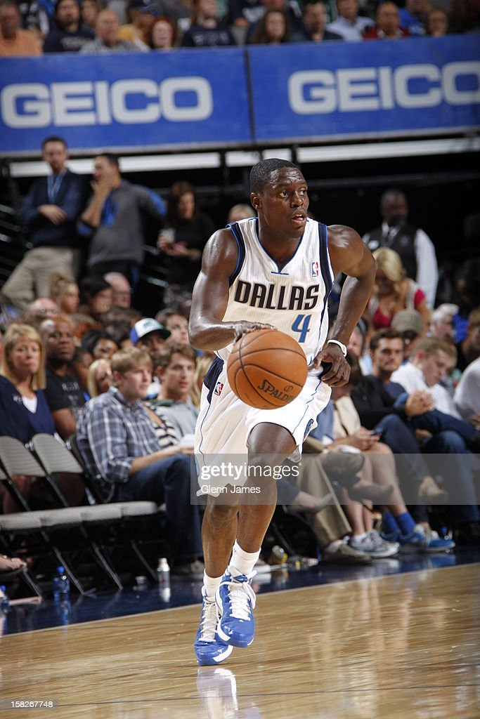 <a gi-track='captionPersonalityLinkClicked' href=/galleries/search?phrase=Darren+Collison&family=editorial&specificpeople=699031 ng-click='$event.stopPropagation()'>Darren Collison</a> #4 of the Dallas Mavericks dribbles the ball up court against the Charlotte Bobcats on November 3, 2012 at the American Airlines Center in Dallas, Texas.
