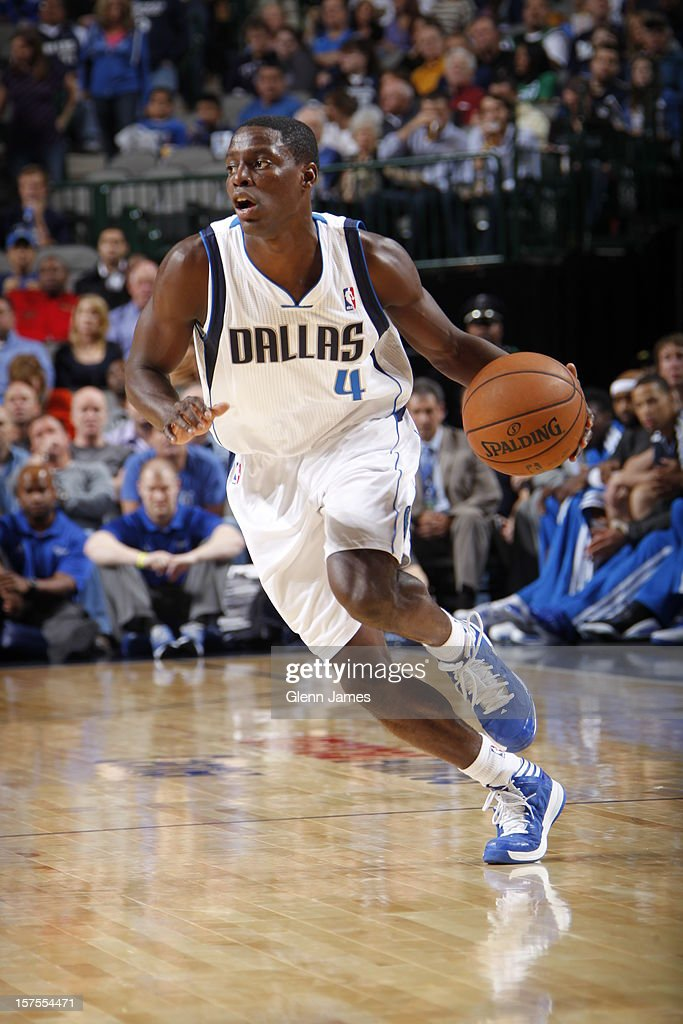 <a gi-track='captionPersonalityLinkClicked' href=/galleries/search?phrase=Darren+Collison&family=editorial&specificpeople=699031 ng-click='$event.stopPropagation()'>Darren Collison</a> #4 of the Dallas Mavericks dribbles the ball upcourt against the Portland Trail Blazers on November 5, 2012 at the American Airlines Center in Dallas, Texas.