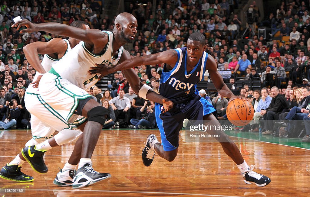 Darren Collison #4 of the Dallas Mavericks drives against Kevin Garnett #5 of the Boston Celtics during the game between the Boston Celtics and the Dallas Mavericks on December 12, 2012 at the TD Garden in Boston, Massachusetts.