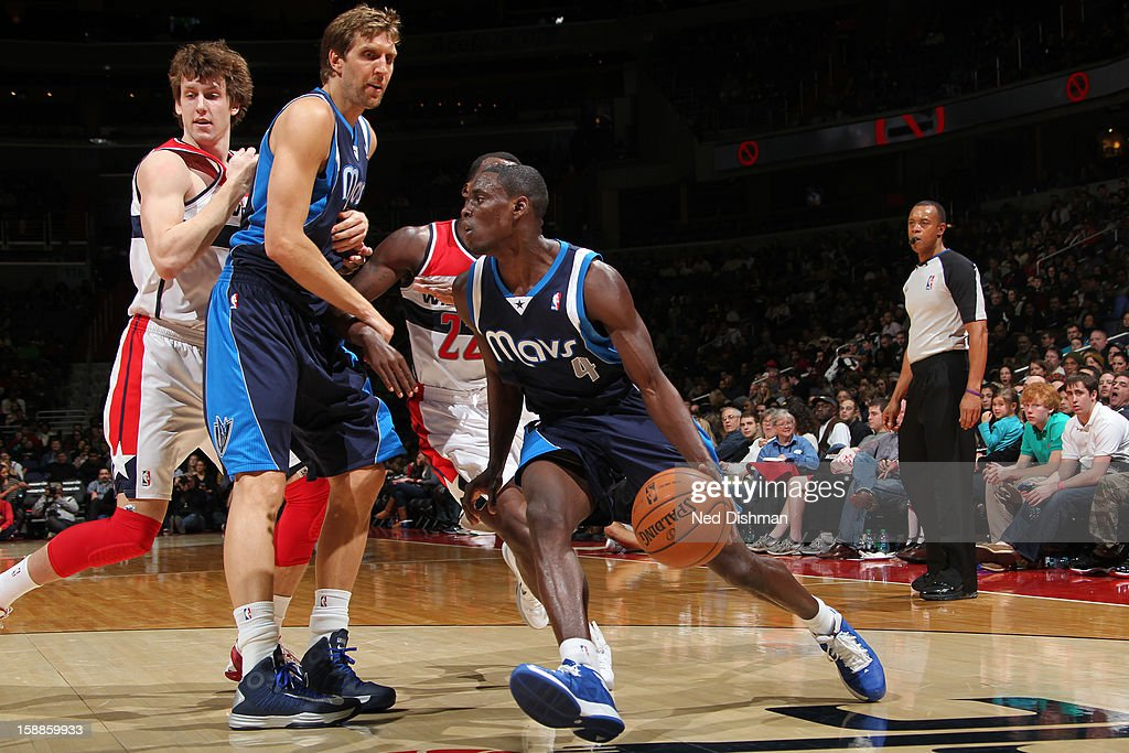 <a gi-track='captionPersonalityLinkClicked' href=/galleries/search?phrase=Darren+Collison&family=editorial&specificpeople=699031 ng-click='$event.stopPropagation()'>Darren Collison</a> #4 of the Dallas Mavericks drives against <a gi-track='captionPersonalityLinkClicked' href=/galleries/search?phrase=Shelvin+Mack&family=editorial&specificpeople=5767272 ng-click='$event.stopPropagation()'>Shelvin Mack</a> #22 and <a gi-track='captionPersonalityLinkClicked' href=/galleries/search?phrase=Jan+Vesely&family=editorial&specificpeople=5620499 ng-click='$event.stopPropagation()'>Jan Vesely</a> #24 of the Washington Wizards during the game at the Verizon Center on January 1, 2013 in Washington, DC.