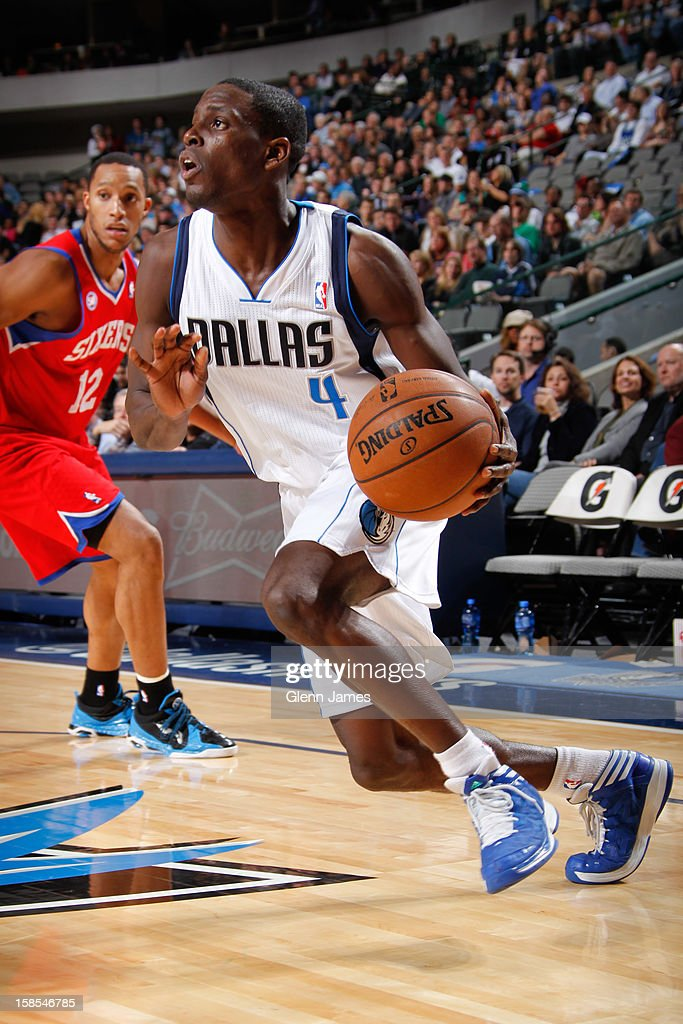 <a gi-track='captionPersonalityLinkClicked' href=/galleries/search?phrase=Darren+Collison&family=editorial&specificpeople=699031 ng-click='$event.stopPropagation()'>Darren Collison</a> #4 of the Dallas Mavericks drives ahead of <a gi-track='captionPersonalityLinkClicked' href=/galleries/search?phrase=Evan+Turner&family=editorial&specificpeople=4665764 ng-click='$event.stopPropagation()'>Evan Turner</a> #12 of the Philadelphia 76ers on December 18, 2012 at the American Airlines Center in Dallas, Texas.