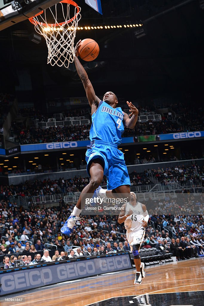 Darren Collison #4 of the Dallas Mavericks drives for a layup against the Brooklyn Nets on March 1, 2013 at the Barclays Center in Brooklyn, New York.