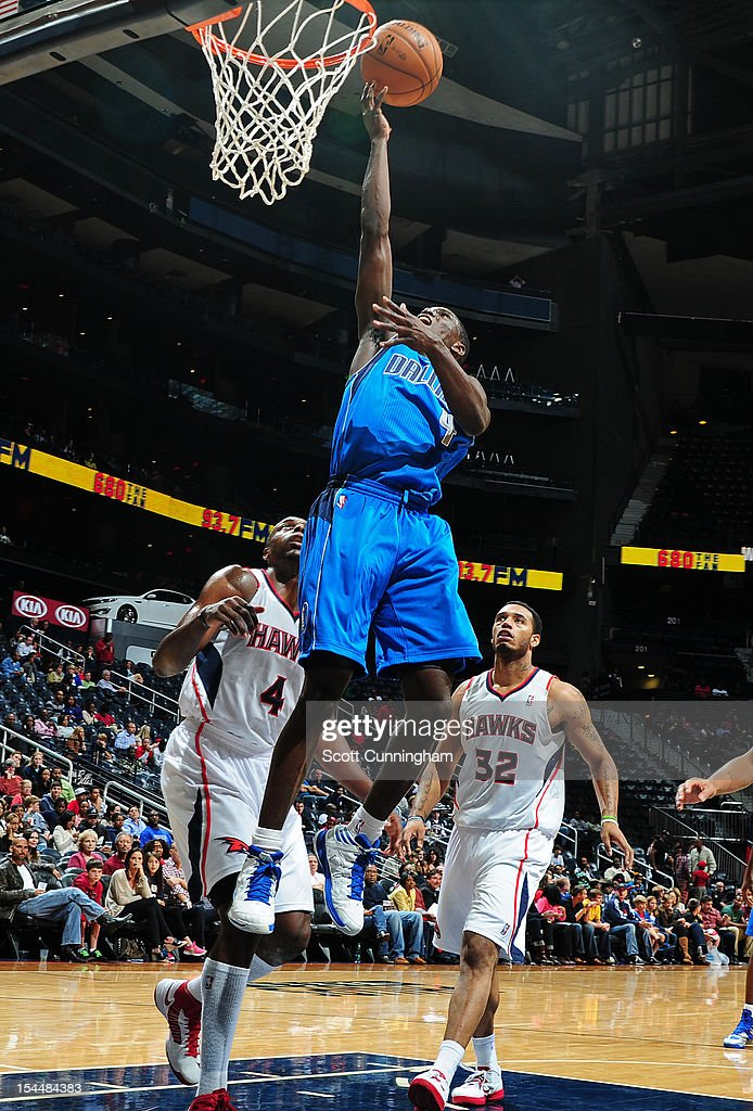 <a gi-track='captionPersonalityLinkClicked' href=/galleries/search?phrase=Darren+Collison&family=editorial&specificpeople=699031 ng-click='$event.stopPropagation()'>Darren Collison</a> #4 of the Dallas Mavericks drives to the basket against the Atlanta Hawks at Philips Arena on October 20, 2012 in Atlanta, Georgia.
