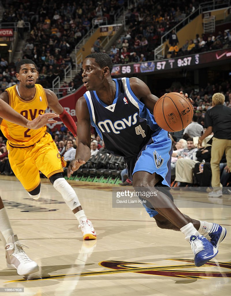 <a gi-track='captionPersonalityLinkClicked' href=/galleries/search?phrase=Darren+Collison&family=editorial&specificpeople=699031 ng-click='$event.stopPropagation()'>Darren Collison</a> #4 of the Dallas Mavericks drives to the basket against <a gi-track='captionPersonalityLinkClicked' href=/galleries/search?phrase=Kyrie+Irving&family=editorial&specificpeople=6893971 ng-click='$event.stopPropagation()'>Kyrie Irving</a> #2 of the Cleveland Cavaliers at The Quicken Loans Arena on November 17, 2012 in Cleveland, Ohio.