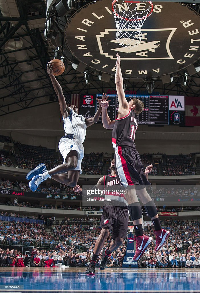 <a gi-track='captionPersonalityLinkClicked' href=/galleries/search?phrase=Darren+Collison&family=editorial&specificpeople=699031 ng-click='$event.stopPropagation()'>Darren Collison</a> #4 of the Dallas Mavericks drives to the basket against <a gi-track='captionPersonalityLinkClicked' href=/galleries/search?phrase=Meyers+Leonard&family=editorial&specificpeople=6893999 ng-click='$event.stopPropagation()'>Meyers Leonard</a> #11 of the Portland Trail Blazers on November 5, 2012 at the American Airlines Center in Dallas, Texas.
