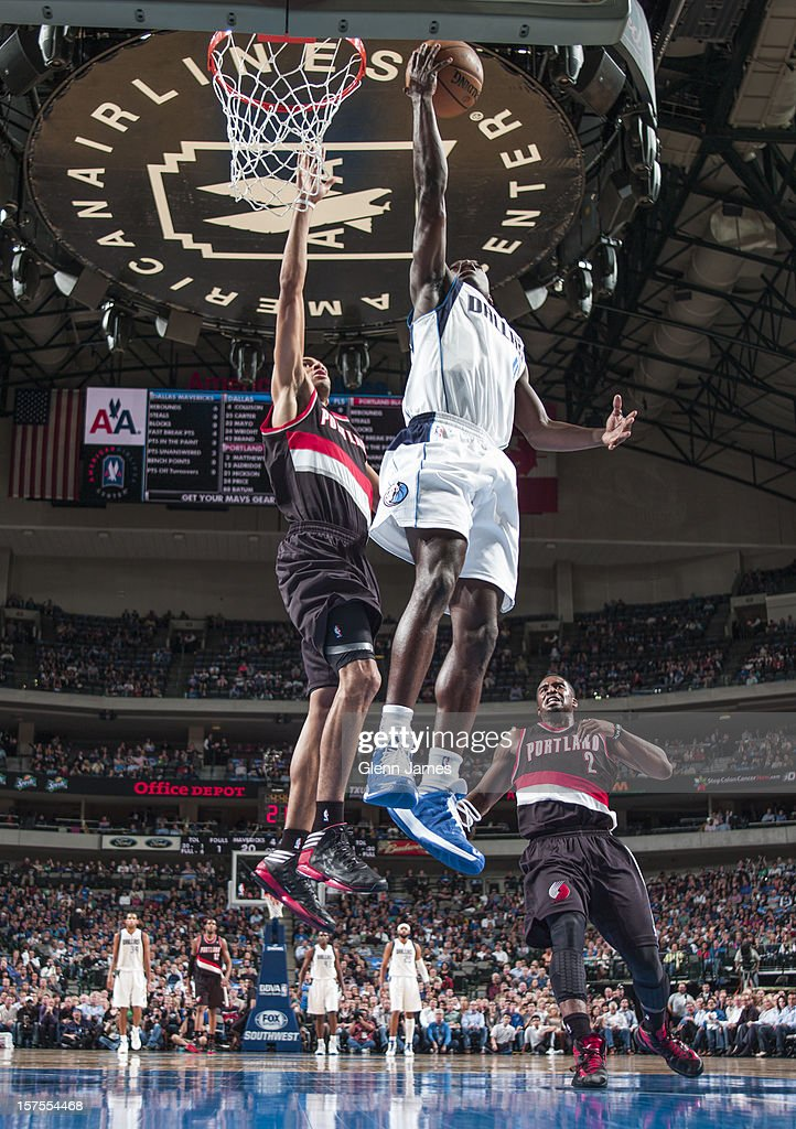 <a gi-track='captionPersonalityLinkClicked' href=/galleries/search?phrase=Darren+Collison&family=editorial&specificpeople=699031 ng-click='$event.stopPropagation()'>Darren Collison</a> #4 of the Dallas Mavericks drives to the basket against <a gi-track='captionPersonalityLinkClicked' href=/galleries/search?phrase=Nicolas+Batum&family=editorial&specificpeople=3746275 ng-click='$event.stopPropagation()'>Nicolas Batum</a> #88 of the Portland Trail Blazers on November 5, 2012 at the American Airlines Center in Dallas, Texas.