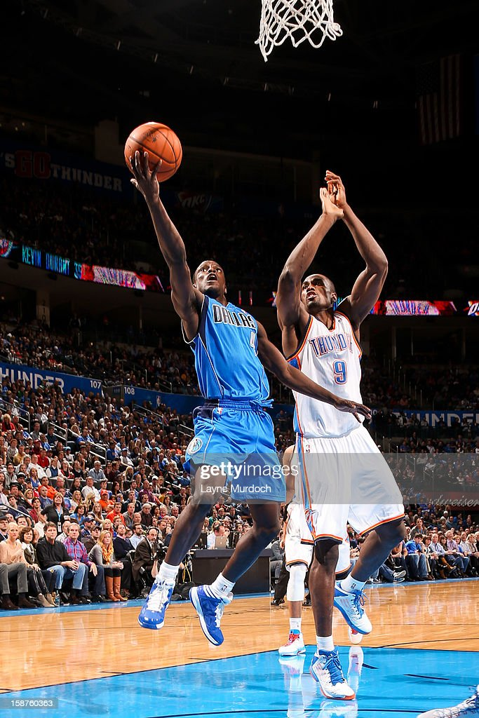 Darren Collison #4 of the Dallas Mavericks drives to the basket against Serge Ibaka #9 of the Oklahoma City Thunder on December 27, 2012 at the Chesapeake Energy Arena in Oklahoma City, Oklahoma.