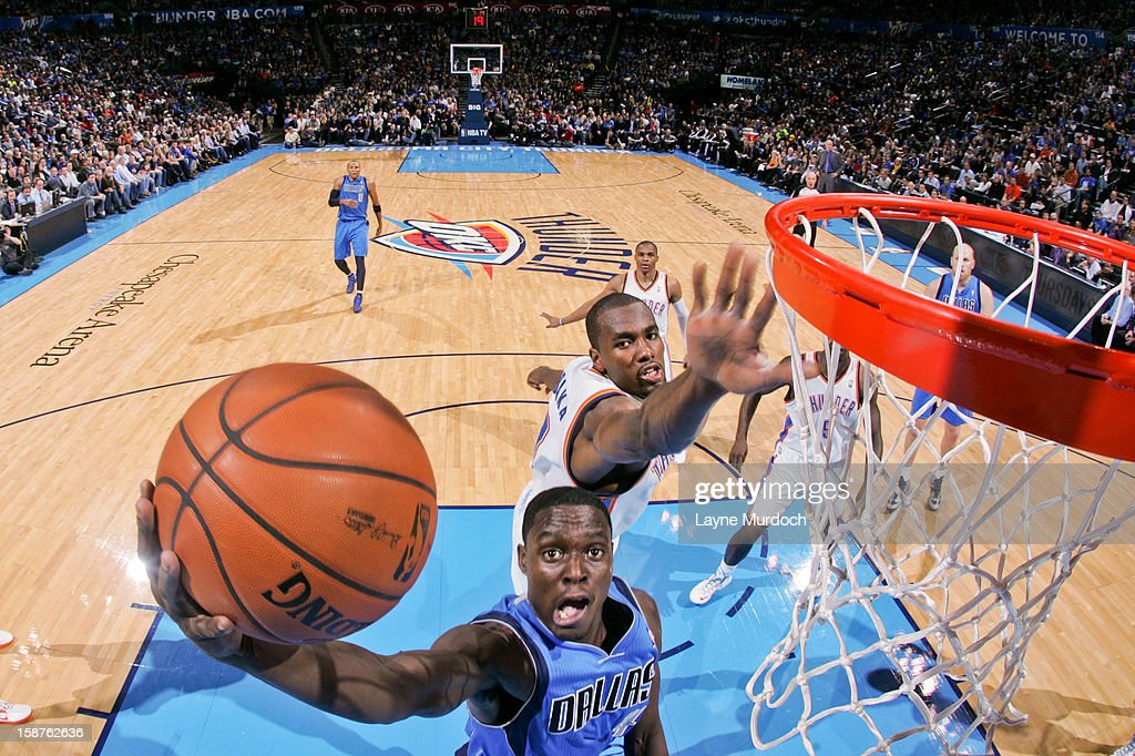 <a gi-track='captionPersonalityLinkClicked' href=/galleries/search?phrase=Darren+Collison&family=editorial&specificpeople=699031 ng-click='$event.stopPropagation()'>Darren Collison</a> #4 of the Dallas Mavericks drives to the basket against <a gi-track='captionPersonalityLinkClicked' href=/galleries/search?phrase=Serge+Ibaka&family=editorial&specificpeople=5133378 ng-click='$event.stopPropagation()'>Serge Ibaka</a> #9 of the Oklahoma City Thunder on December 27, 2012 at the Chesapeake Energy Arena in Oklahoma City, Oklahoma.