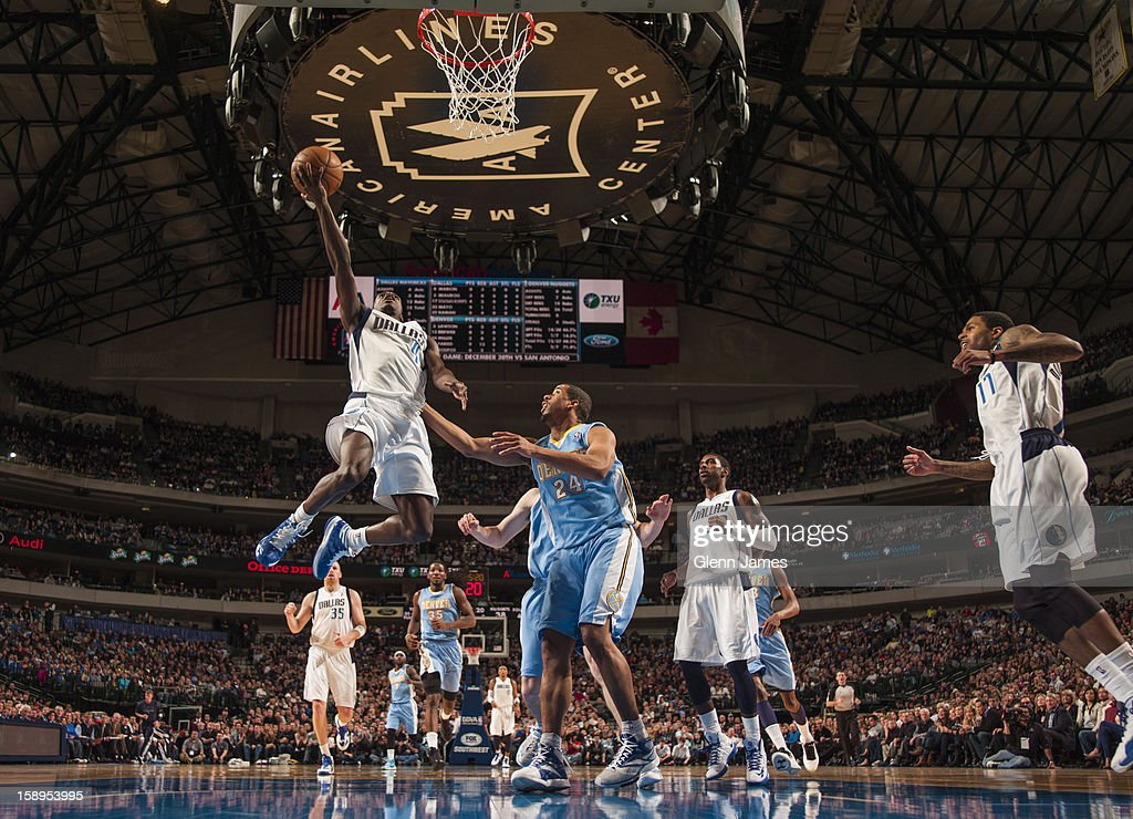 <a gi-track='captionPersonalityLinkClicked' href=/galleries/search?phrase=Darren+Collison&family=editorial&specificpeople=699031 ng-click='$event.stopPropagation()'>Darren Collison</a> #4 of the Dallas Mavericks drives to the basket against the Denver Nuggets on December 28, 2012 at the American Airlines Center in Dallas, Texas.