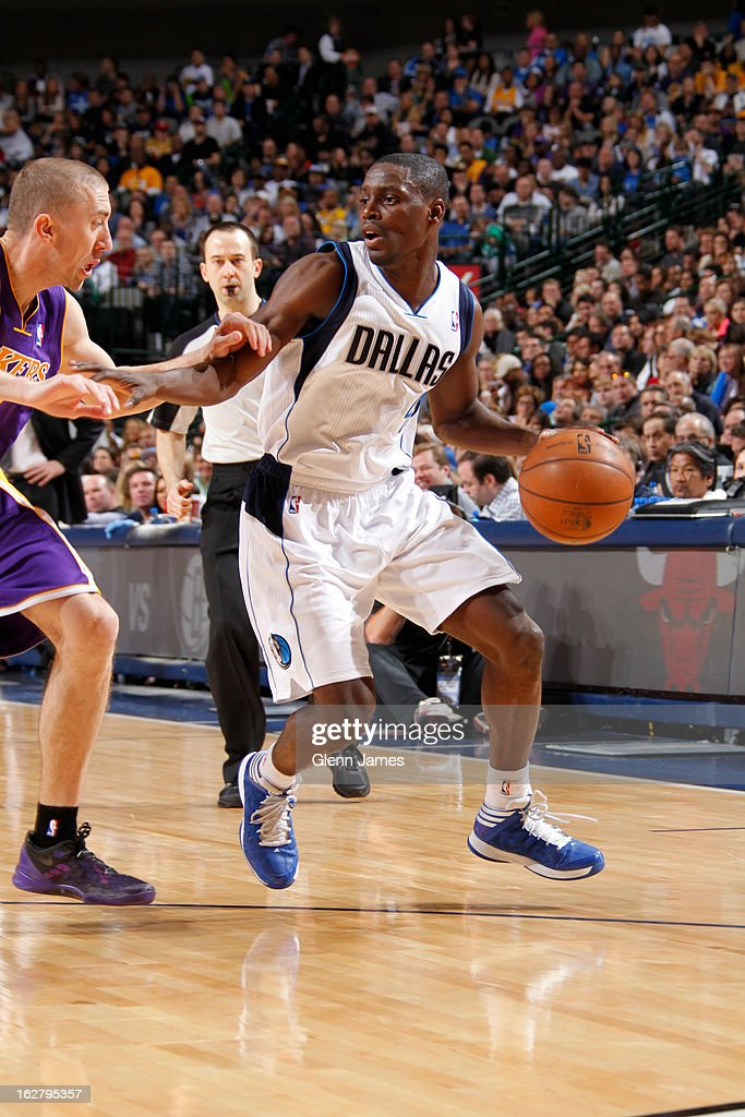 <a gi-track='captionPersonalityLinkClicked' href=/galleries/search?phrase=Darren+Collison&family=editorial&specificpeople=699031 ng-click='$event.stopPropagation()'>Darren Collison</a> #4 of the Dallas Mavericks drives to the basket against the Los Angeles Lakers on February 24, 2013 at the American Airlines Center in Dallas, Texas.