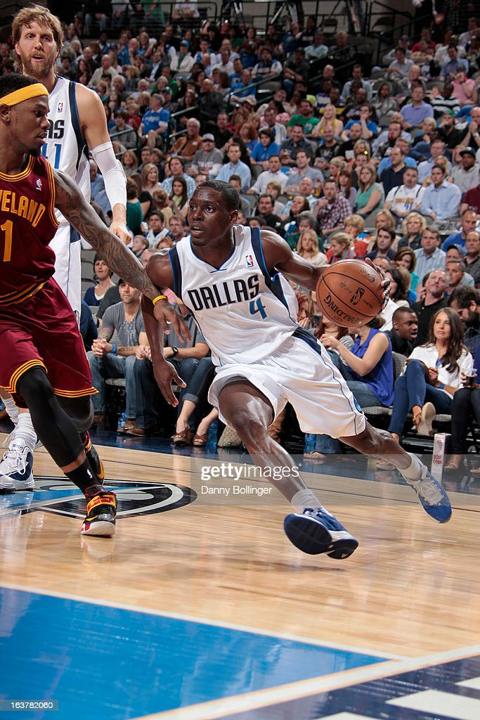 <a gi-track='captionPersonalityLinkClicked' href=/galleries/search?phrase=Darren+Collison&family=editorial&specificpeople=699031 ng-click='$event.stopPropagation()'>Darren Collison</a> #4 of the Dallas Mavericks drives to the basket against <a gi-track='captionPersonalityLinkClicked' href=/galleries/search?phrase=Daniel+Gibson&family=editorial&specificpeople=213906 ng-click='$event.stopPropagation()'>Daniel Gibson</a> #1 of the Cleveland Cavaliers on March 15, 2013 at the American Airlines Center in Dallas, Texas.