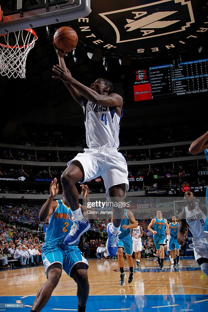 Darren Collison #4 of the Dallas Mavericks drives to the basket against the New Orleans Hornets on April 17, 2013 at the American Airlines Center in Dallas, Texas.