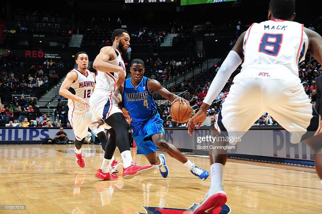 <a gi-track='captionPersonalityLinkClicked' href=/galleries/search?phrase=Darren+Collison&family=editorial&specificpeople=699031 ng-click='$event.stopPropagation()'>Darren Collison</a> #4 of the Dallas Mavericks drives to the basket against the Atlanta Hawks on March 18, 2013 at Philips Arena in Atlanta, Georgia.