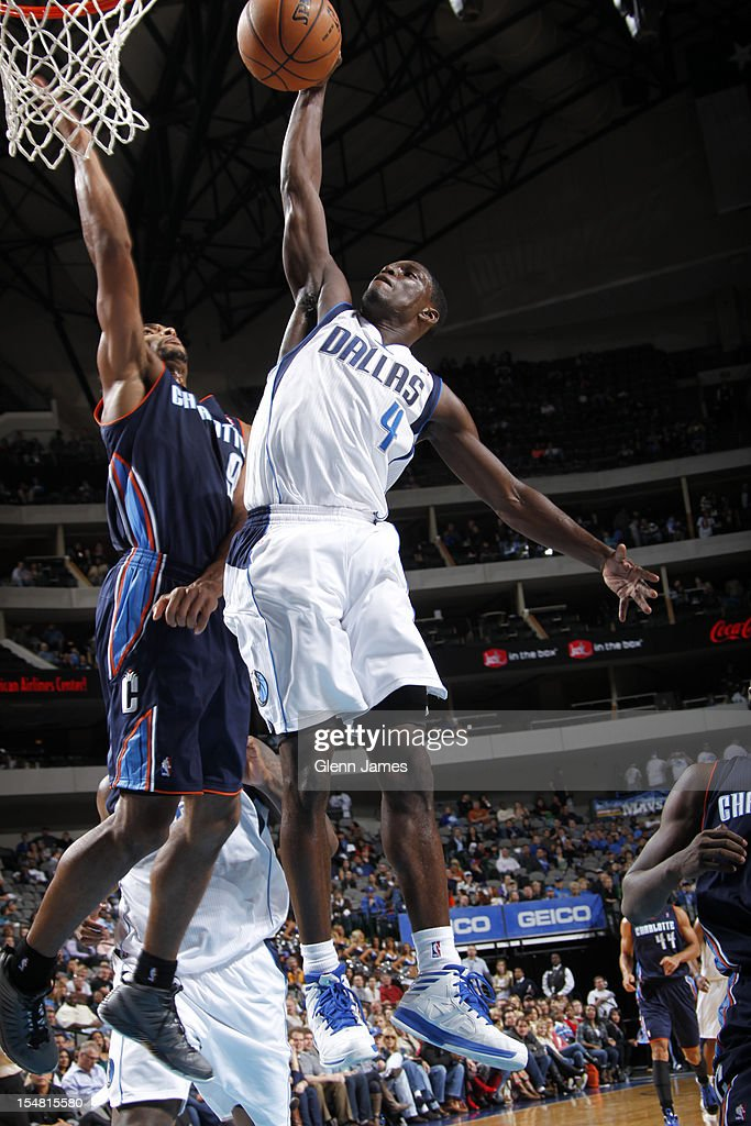 <a gi-track='captionPersonalityLinkClicked' href=/galleries/search?phrase=Darren+Collison&family=editorial&specificpeople=699031 ng-click='$event.stopPropagation()'>Darren Collison</a> #4 of the Dallas Mavericks flies in for the dunk against Gerald Henderson #9 of the Charlotte Bobcats on October 26, 2012 at the American Airlines Center in Dallas, Texas.