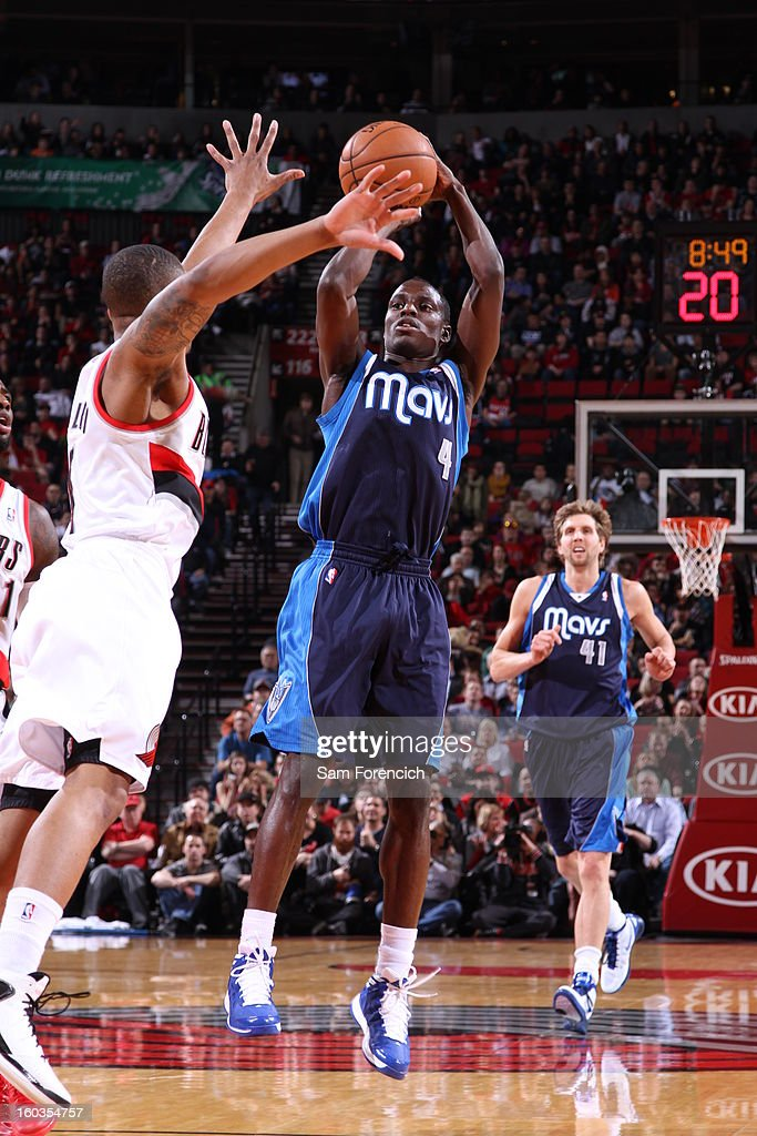 Darren Collison #4 of the Dallas Mavericks goes for a jump shot during the game between the Dallas Mavericks and the Portland Trail Blazers on January 29, 2013 at the Rose Garden Arena in Portland, Oregon.