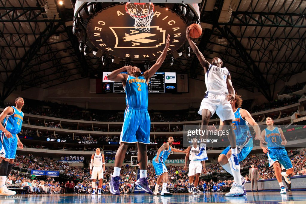 <a gi-track='captionPersonalityLinkClicked' href=/galleries/search?phrase=Darren+Collison&family=editorial&specificpeople=699031 ng-click='$event.stopPropagation()'>Darren Collison</a> #4 of the Dallas Mavericks goes in for the layup against <a gi-track='captionPersonalityLinkClicked' href=/galleries/search?phrase=Darius+Miller&family=editorial&specificpeople=5590631 ng-click='$event.stopPropagation()'>Darius Miller</a> #2 of the New Orleans Hornets on October 22, 2012 at the American Airlines Center in Dallas, Texas.