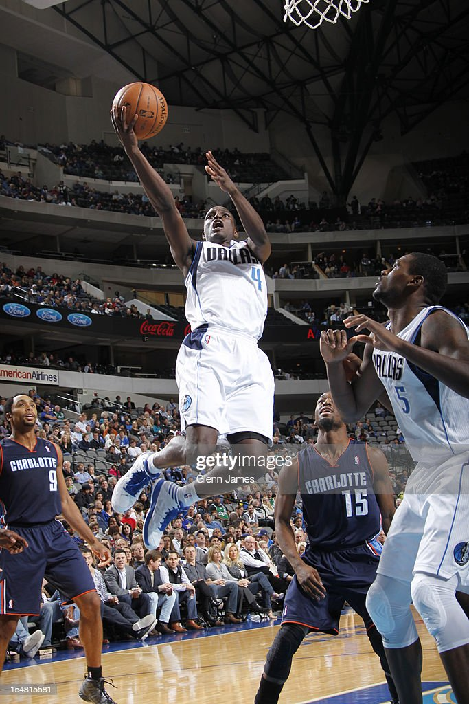 <a gi-track='captionPersonalityLinkClicked' href=/galleries/search?phrase=Darren+Collison&family=editorial&specificpeople=699031 ng-click='$event.stopPropagation()'>Darren Collison</a> #4 of the Dallas Mavericks goes in for the layup against the Charlotte Bobcats on October 26, 2012 at the American Airlines Center in Dallas, Texas.