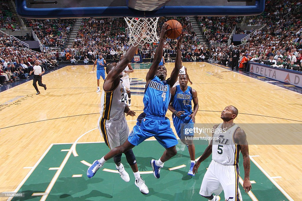 <a gi-track='captionPersonalityLinkClicked' href=/galleries/search?phrase=Darren+Collison&family=editorial&specificpeople=699031 ng-click='$event.stopPropagation()'>Darren Collison</a> #4 of the Dallas Mavericks goes to the hoop against <a gi-track='captionPersonalityLinkClicked' href=/galleries/search?phrase=Paul+Millsap&family=editorial&specificpeople=880017 ng-click='$event.stopPropagation()'>Paul Millsap</a> #24 and <a gi-track='captionPersonalityLinkClicked' href=/galleries/search?phrase=Randy+Foye&family=editorial&specificpeople=240185 ng-click='$event.stopPropagation()'>Randy Foye</a> #8 of the Utah Jazz at Energy Solutions Arena on October 31, 2012 in Salt Lake City, Utah.