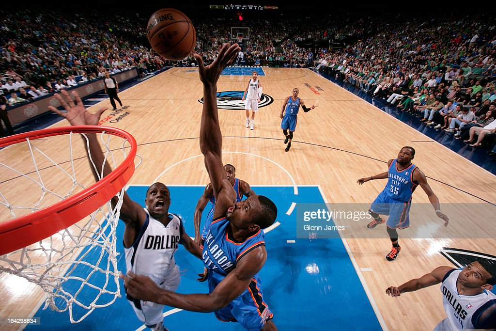 Darren Collison #4 of the Dallas Mavericks goes up for a rebound against Serge Ibaka #9 of the Oklahoma City Thunder on March 17, 2013 at the American Airlines Center in Dallas, Texas.