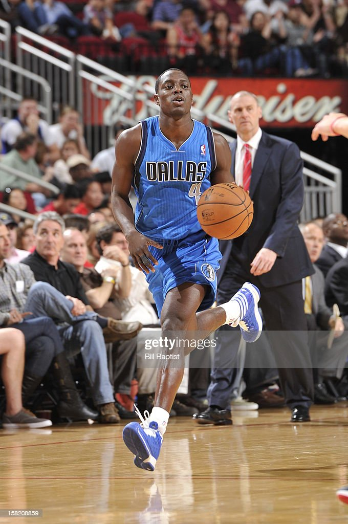 <a gi-track='captionPersonalityLinkClicked' href=/galleries/search?phrase=Darren+Collison&family=editorial&specificpeople=699031 ng-click='$event.stopPropagation()'>Darren Collison</a> #4 of the Dallas Mavericks handles the ball against the Houston Rockets on December 8, 2012 at the Toyota Center in Houston, Texas.