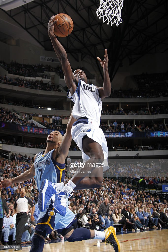 <a gi-track='captionPersonalityLinkClicked' href=/galleries/search?phrase=Darren+Collison&family=editorial&specificpeople=699031 ng-click='$event.stopPropagation()'>Darren Collison</a> #4 of the Dallas Mavericks lays it up against <a gi-track='captionPersonalityLinkClicked' href=/galleries/search?phrase=Jerryd+Bayless&family=editorial&specificpeople=4216027 ng-click='$event.stopPropagation()'>Jerryd Bayless</a> #7 of the Memphis Grizzlies on January 12, 2013 at the American Airlines Center in Dallas, Texas.