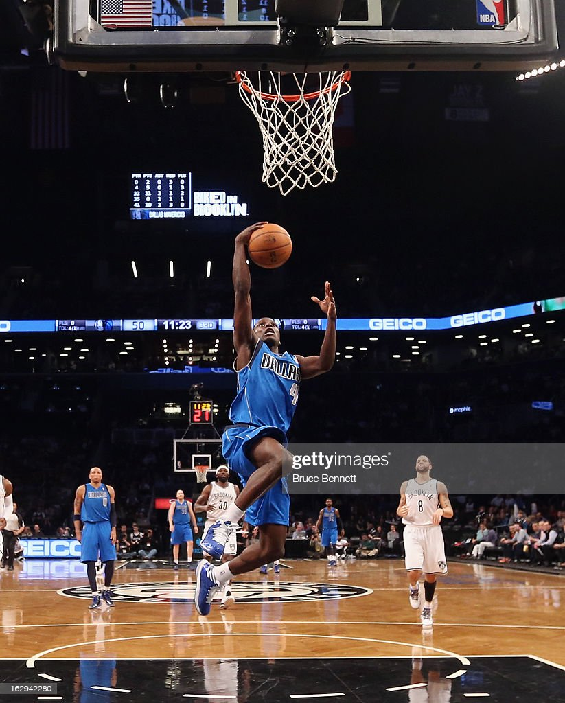 Darren Collison #4 of the Dallas Mavericks leads the field and scores in the second half against the Brooklyn Nets at the Barclays Center on March 1, 2013 in New York City.