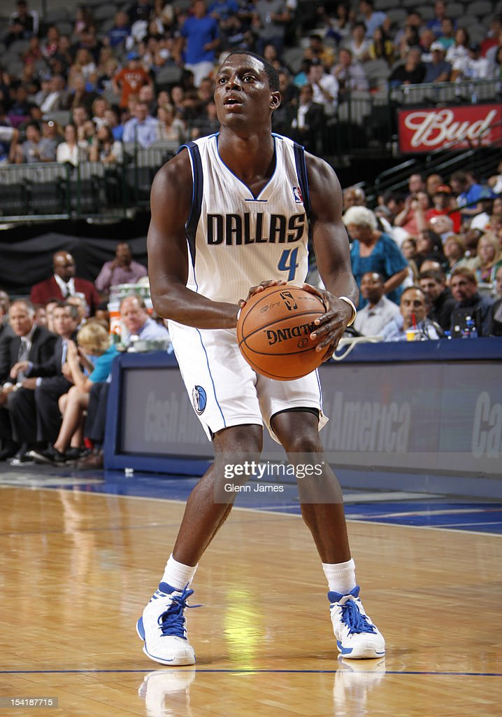 <a gi-track='captionPersonalityLinkClicked' href=/galleries/search?phrase=Darren+Collison&family=editorial&specificpeople=699031 ng-click='$event.stopPropagation()'>Darren Collison</a> #4 of the Dallas Mavericks pulls up for a three against the Houston Rockets on October 15, 2012 at the American Airlines Center in Dallas, Texas.