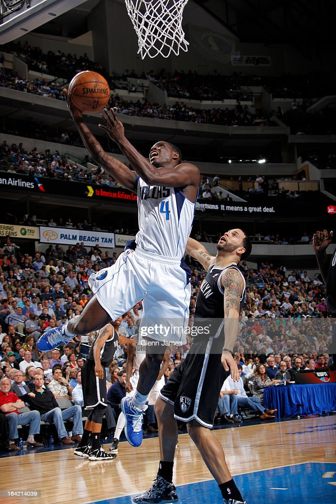 Darren Collison #4 of the Dallas Mavericks shoots a layup against Deron Williams #8 of the Brooklyn Nets on March 20, 2013 at the American Airlines Center in Dallas, Texas.