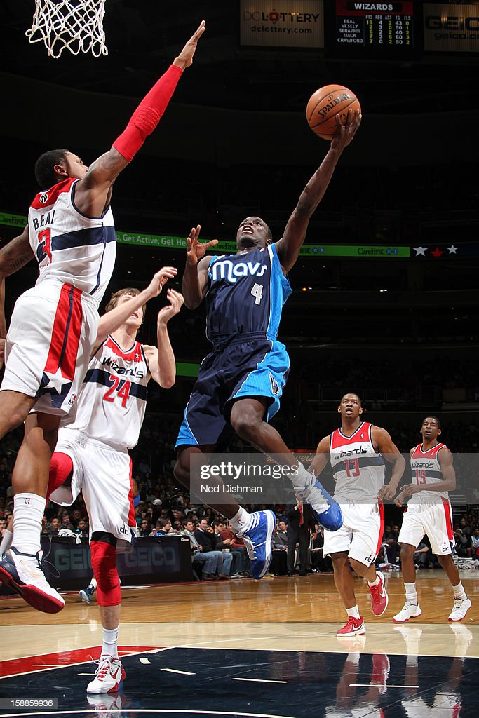 <a gi-track='captionPersonalityLinkClicked' href=/galleries/search?phrase=Darren+Collison&family=editorial&specificpeople=699031 ng-click='$event.stopPropagation()'>Darren Collison</a> #4 of the Dallas Mavericks shoots against <a gi-track='captionPersonalityLinkClicked' href=/galleries/search?phrase=Bradley+Beal&family=editorial&specificpeople=7640439 ng-click='$event.stopPropagation()'>Bradley Beal</a> #3 and <a gi-track='captionPersonalityLinkClicked' href=/galleries/search?phrase=Jan+Vesely&family=editorial&specificpeople=5620499 ng-click='$event.stopPropagation()'>Jan Vesely</a> #24 of the Washington Wizards during the game at the Verizon Center on January 1, 2013 in Washington, DC.