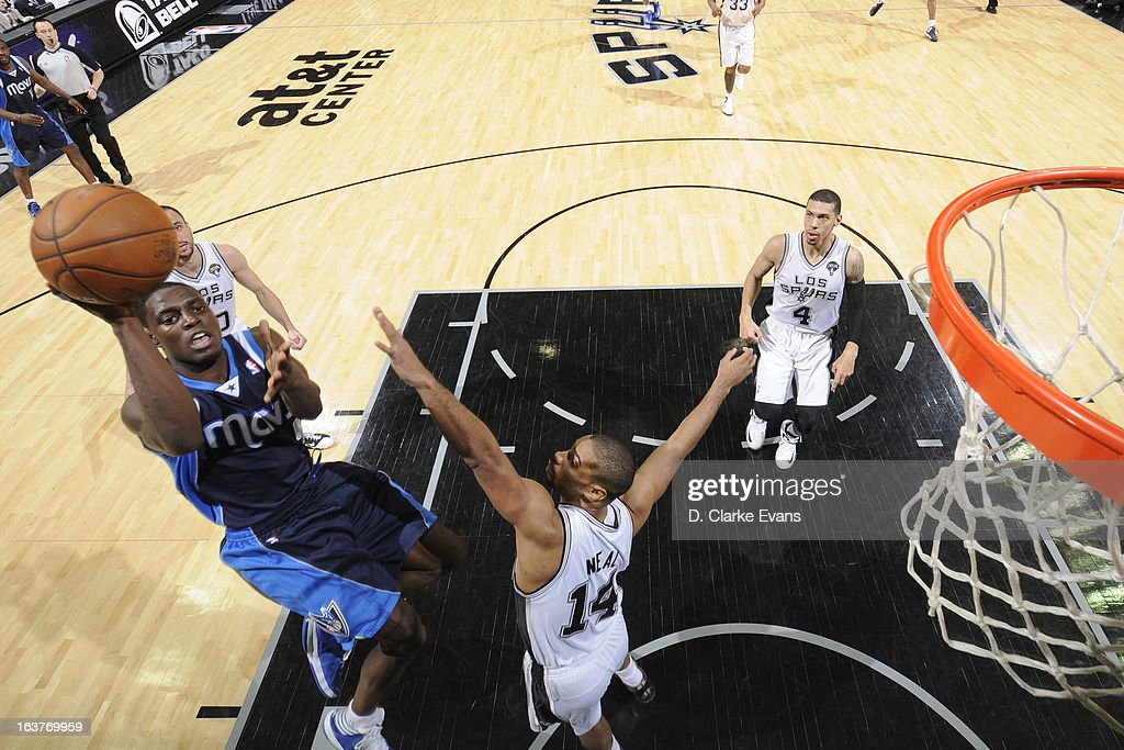 Darren Collison #4 of the Dallas Mavericks shoots against <a gi-track='captionPersonalityLinkClicked' href=/galleries/search?phrase=Gary+Neal&family=editorial&specificpeople=5085165 ng-click='$event.stopPropagation()'>Gary Neal</a> #14 of the San Antonio Spurs on March 14, 2013 at the AT&T Center in San Antonio, Texas.