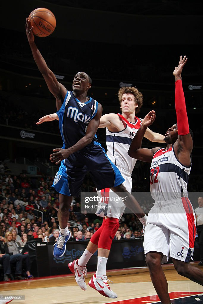 <a gi-track='captionPersonalityLinkClicked' href=/galleries/search?phrase=Darren+Collison&family=editorial&specificpeople=699031 ng-click='$event.stopPropagation()'>Darren Collison</a> #4 of the Dallas Mavericks shoots against <a gi-track='captionPersonalityLinkClicked' href=/galleries/search?phrase=Shelvin+Mack&family=editorial&specificpeople=5767272 ng-click='$event.stopPropagation()'>Shelvin Mack</a> #22 and <a gi-track='captionPersonalityLinkClicked' href=/galleries/search?phrase=Jan+Vesely&family=editorial&specificpeople=5620499 ng-click='$event.stopPropagation()'>Jan Vesely</a> #24 of the Washington Wizards during the game at the Verizon Center on January 1, 2013 in Washington, DC.