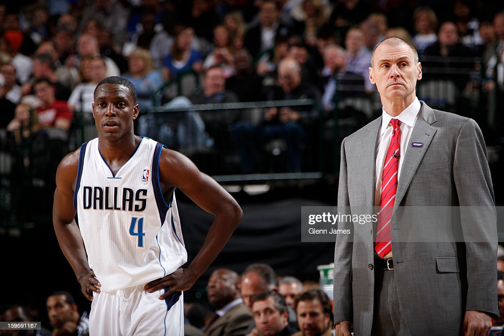 Darren Collison #4 of the Dallas Mavericks stands next to head coach Rick Carlisle during a stop in the action against the Houston Rockets on January 16, 2013 at the American Airlines Center in Dallas, Texas.