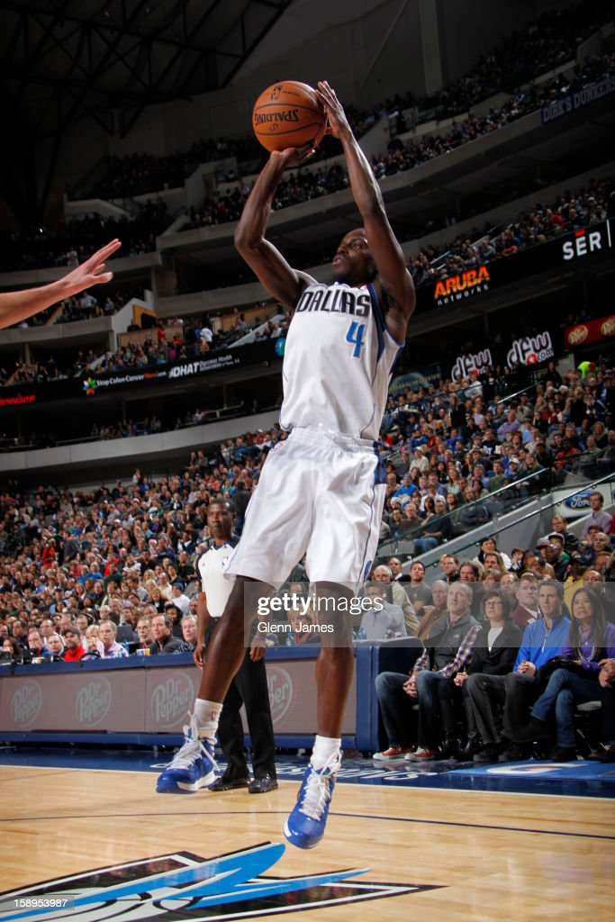 <a gi-track='captionPersonalityLinkClicked' href=/galleries/search?phrase=Darren+Collison&family=editorial&specificpeople=699031 ng-click='$event.stopPropagation()'>Darren Collison</a> #4 of the Dallas Mavericks takes a shot against the Denver Nuggets on December 28, 2012 at the American Airlines Center in Dallas, Texas.