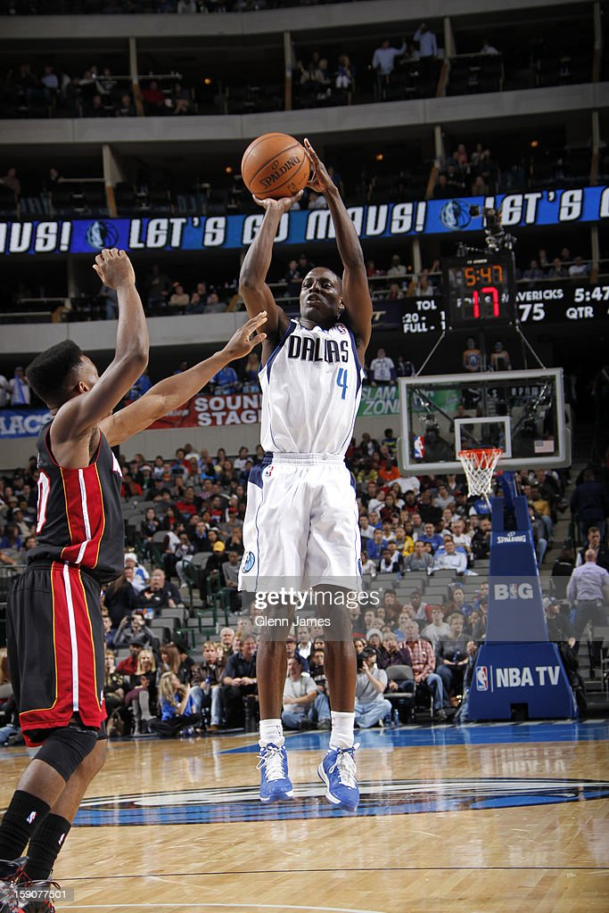 <a gi-track='captionPersonalityLinkClicked' href=/galleries/search?phrase=Darren+Collison&family=editorial&specificpeople=699031 ng-click='$event.stopPropagation()'>Darren Collison</a> #4 of the Dallas Mavericks takes a shot against the Miami Heat on December 20, 2012 at the American Airlines Center in Dallas, Texas.