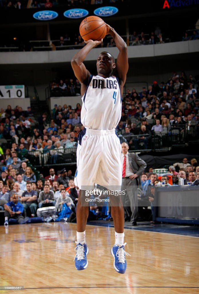 <a gi-track='captionPersonalityLinkClicked' href=/galleries/search?phrase=Darren+Collison&family=editorial&specificpeople=699031 ng-click='$event.stopPropagation()'>Darren Collison</a> #4 of the Dallas Mavericks takes a shot against the Houston Rockets on January 16, 2013 at the American Airlines Center in Dallas, Texas.