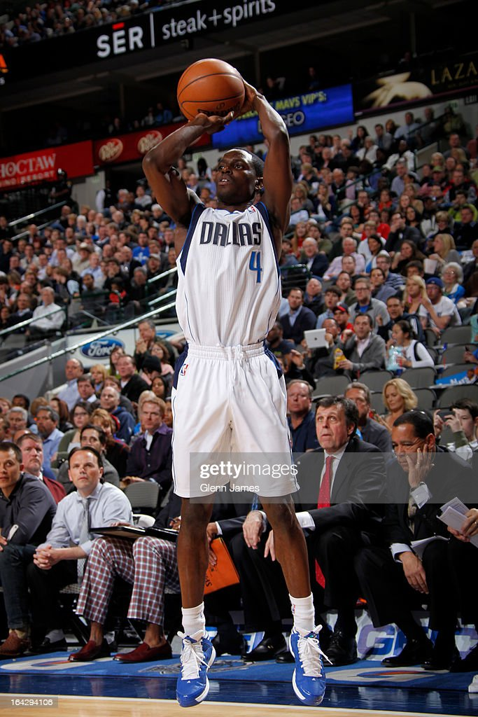 <a gi-track='captionPersonalityLinkClicked' href=/galleries/search?phrase=Darren+Collison&family=editorial&specificpeople=699031 ng-click='$event.stopPropagation()'>Darren Collison</a> #4 of the Dallas Mavericks takes a shot against the Houston Rockets on March 6, 2013 at the American Airlines Center in Dallas, Texas.