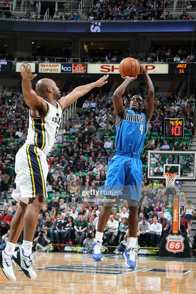 <a gi-track='captionPersonalityLinkClicked' href=/galleries/search?phrase=Darren+Collison&family=editorial&specificpeople=699031 ng-click='$event.stopPropagation()'>Darren Collison</a> #4 of the Dallas Mavericks takes a shot against the Utah Jazz on January 7, 2013 in Salt Lake City, Utah.